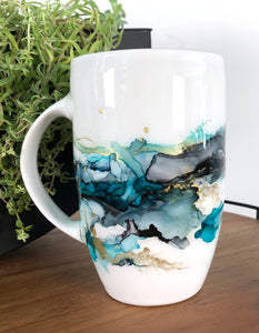 left view Sea teal, midnight black, and copper alcohol ink hand-painted on 20 oz porcelain coffee mug. Signed by the artist, Jaylin Knutson.
