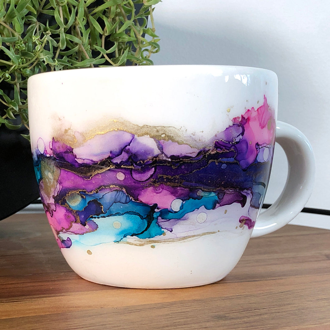 Pink, teal, purple, and gold alcohol ink hand-painted on 16oz stoneware coffee mug. Signed by the artist, Jaylin Knutson. right view