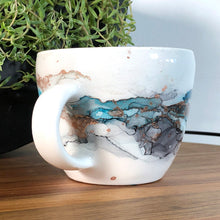Load image into Gallery viewer, Sea teal, black and copper alcohol ink hand-painted on 16oz stoneware coffee mug. Signed by the artist, Jaylin Knutson. handle view