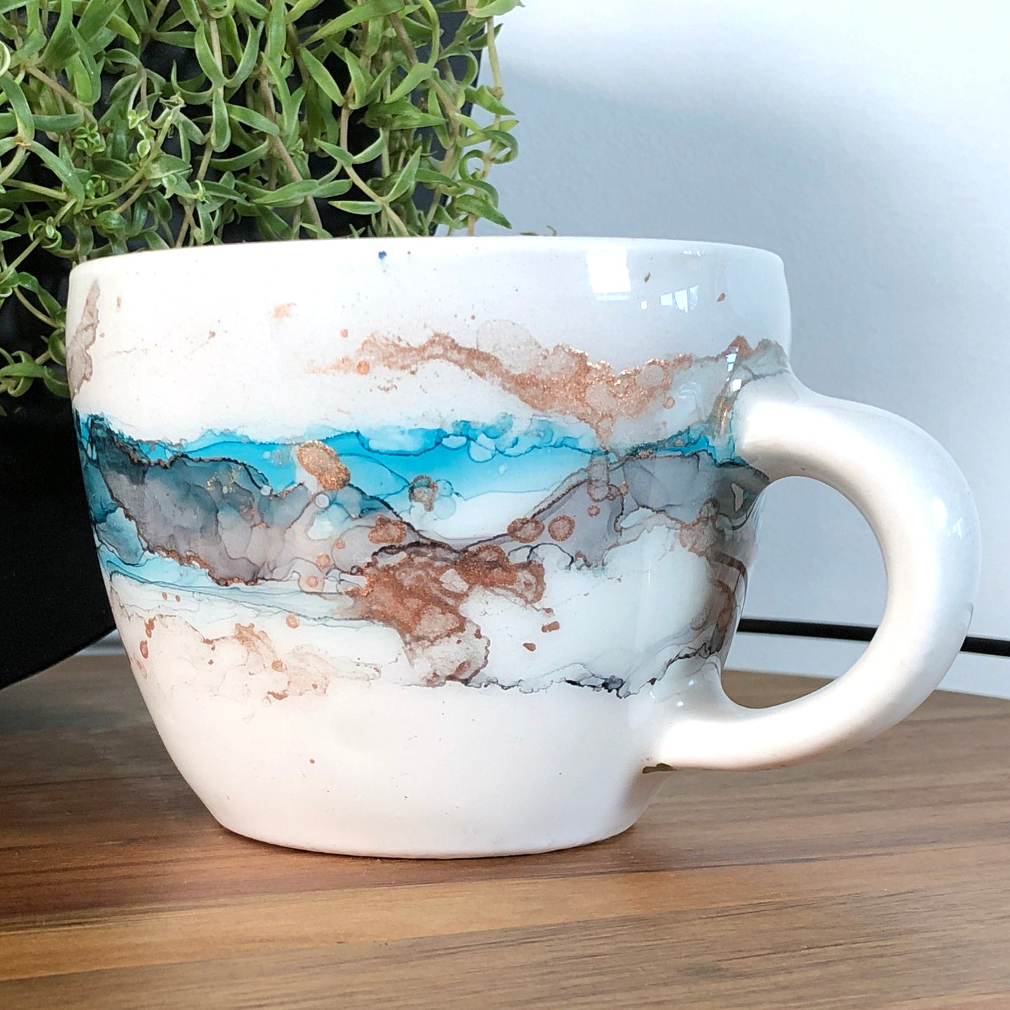 Sea teal, black and copper alcohol ink hand-painted on 16oz stoneware coffee mug. Signed by the artist, Jaylin Knutson. right side