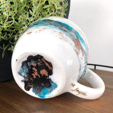Load image into Gallery viewer, Sea teal, black and copper alcohol ink hand-painted on 16oz stoneware coffee mug. Signed by the artist, Jaylin Knutson. bottom view