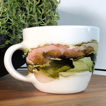 Load image into Gallery viewer, left view Forest green, salmon, sandy brown and copper alcohol ink hand-painted on 16oz stoneware coffee mug. Signed by the artist, Jaylin Knutson.