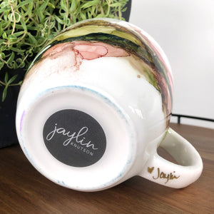 signature on bottom Forest green, salmon, sandy brown and copper alcohol ink hand-painted on 16oz stoneware coffee mug. Signed by the artist, Jaylin Knutson.