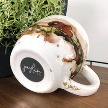 Load image into Gallery viewer, signature on bottom Forest green, salmon, sandy brown and copper alcohol ink hand-painted on 16oz stoneware coffee mug. Signed by the artist, Jaylin Knutson.