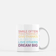 Load image into Gallery viewer, white ceramic mug with unicorn color writing saying Smile often. Think positively. Give thanks. Laugh often. Love others. Dream big. plain white background
