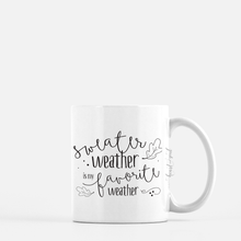 Load image into Gallery viewer, white ceramic mug with black writing saying sweater weather is my favorite weather . plain white background