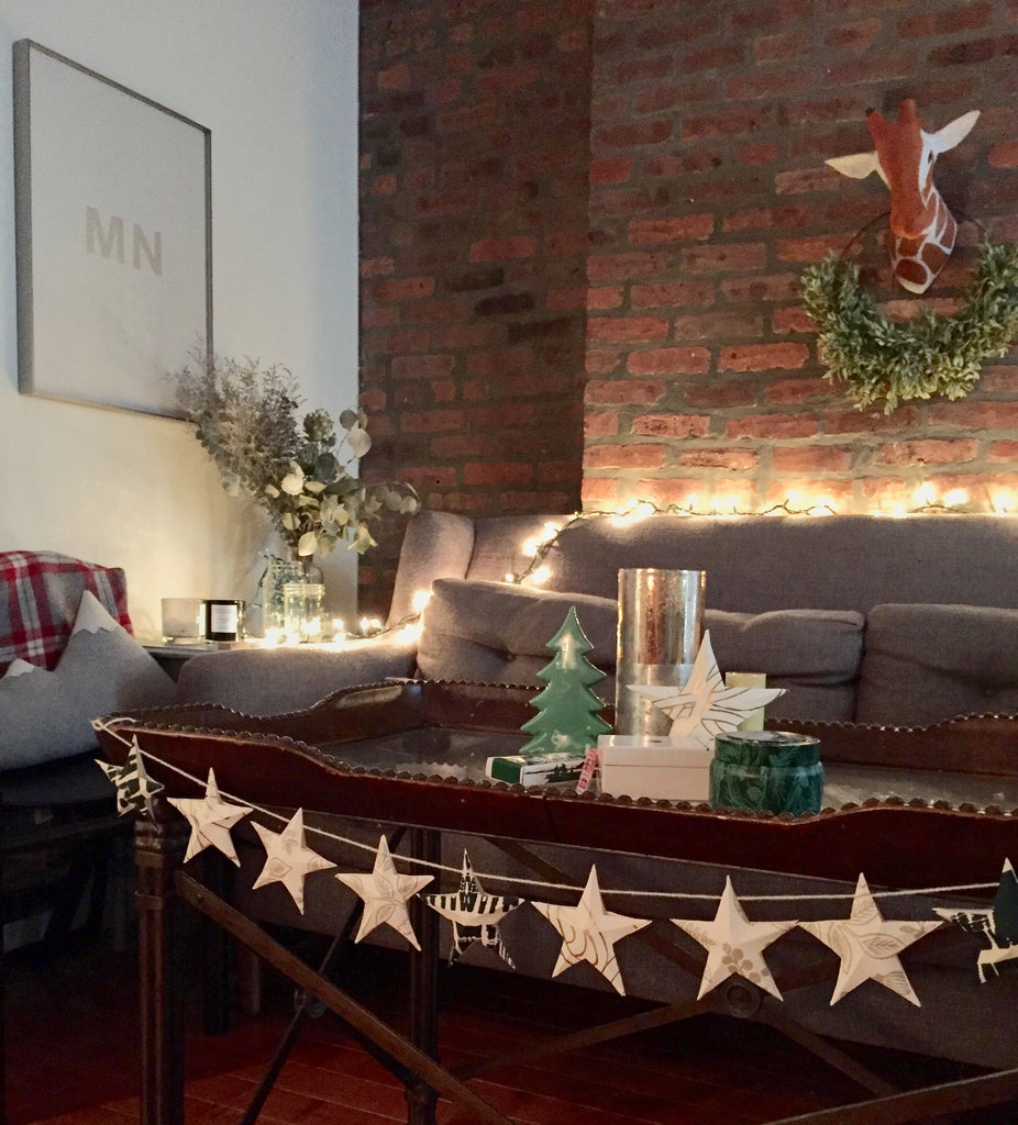 NYC apartment paper garland DIY christmas decor Hygge & West wallpaper