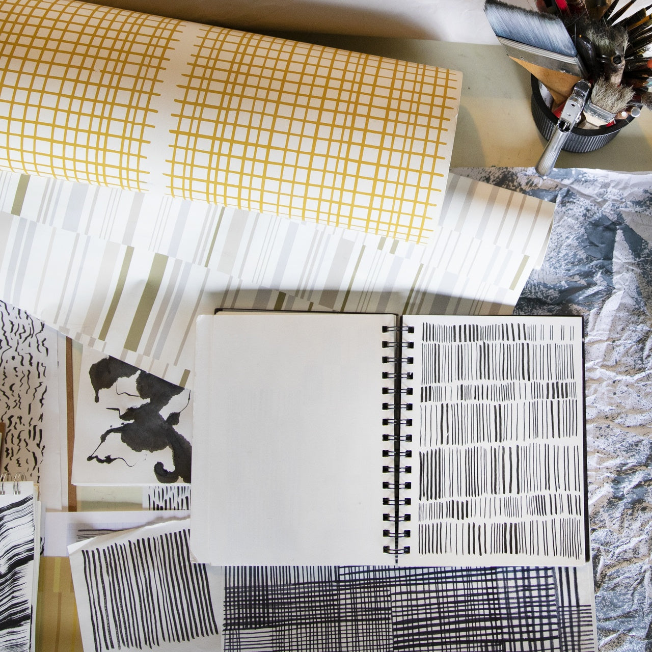 Jennifer Stady of Laundry Studio works on her wallpaper designs in her Portland studio   Meet the designers behind the new Schoolhouse + Hygge & West wallpaper collection