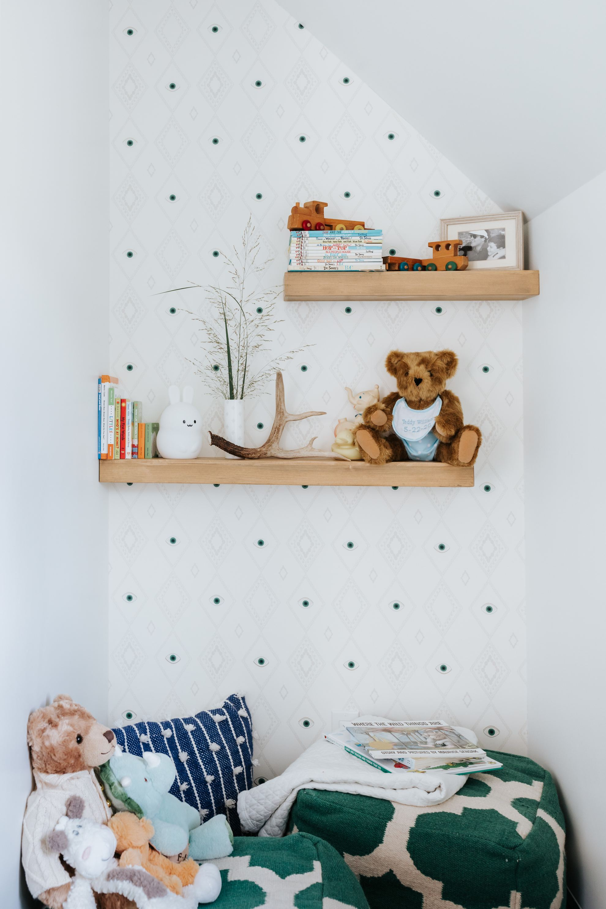 Little boy's nursery reading nook by Samantha Pappas featuring Evil Eye wallpaper in Green by Coral & Tusk for Hygge & West