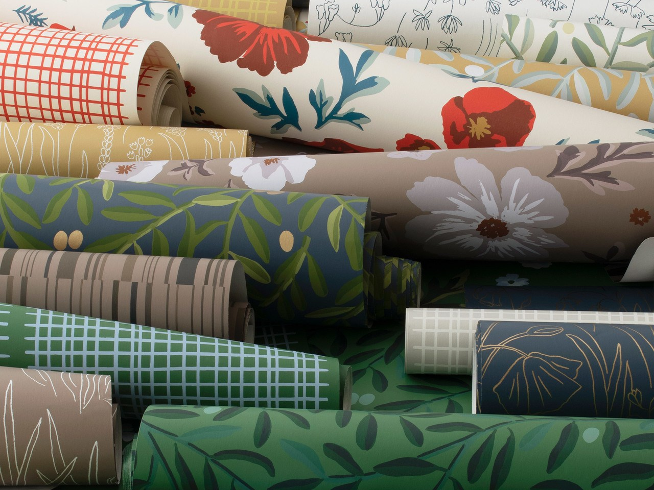 Rolls of various wallpapers   Meet the designers behind the new Schoolhouse + Hygge & West wallpaper collection