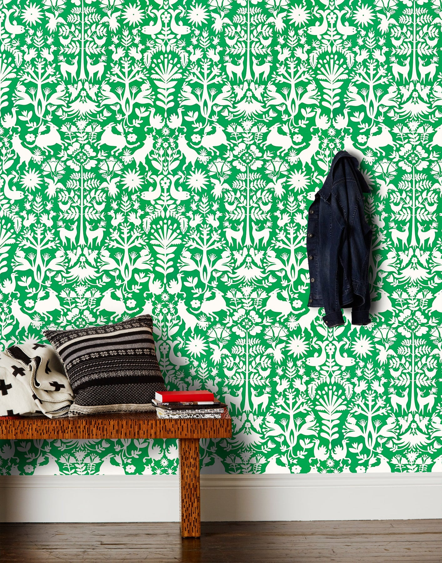 Otomi (Jade) wallpaper featuring a white Otomi meets Scandinavian folk pattern on a green background | Hygge & West x Emily Isabella