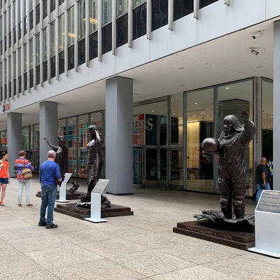 10 bronze sculptures of powerful women are on view outside a Midtown office building