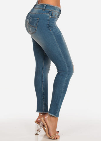 Trendy Mid Rise Distressed Med Wash Raw Hem Skinny Jeans