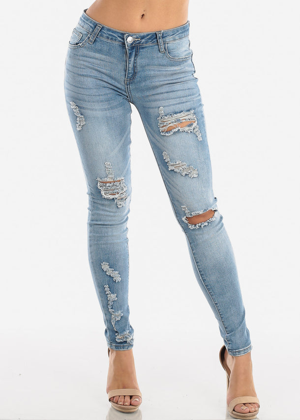 Mid Rise Ripped Whiskered Skinny Jeans