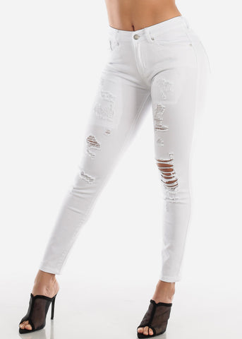 Image of Torn High Rise White Skinny Jeans
