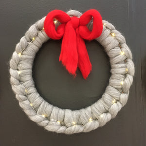 Wreath with fairy lights and bow