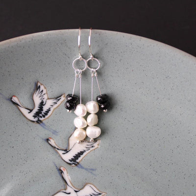 Black spinel and white pearl earrings