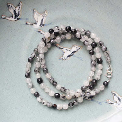 Black and white semiprecious stone mask chain