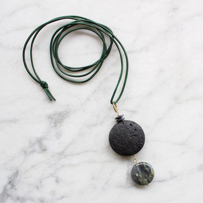 Black stone pendant on green leather necklace