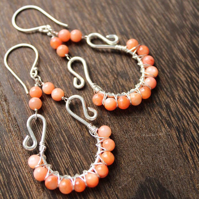 Orange mother of pearl statement earrings