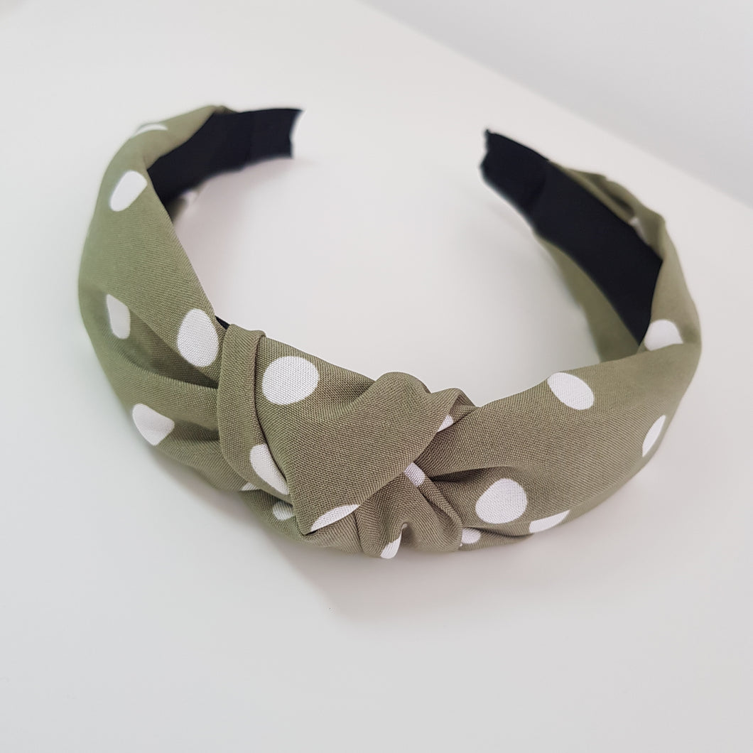 Green with white polka dots alice band