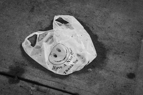plastic bag laying on the ground
