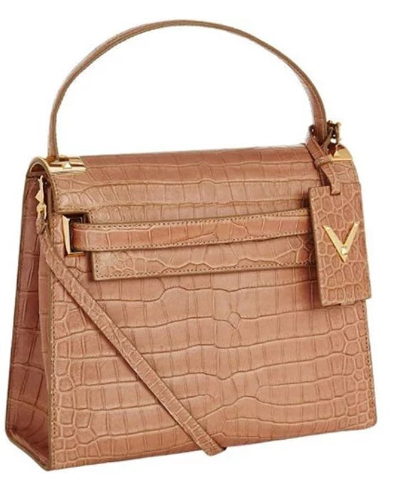 33d9bd5055fc But the brand earned a place on the list of most expensive bags with their   My Rockstud Tote  made out of crocodile skin. And these rock stud purses  are ...