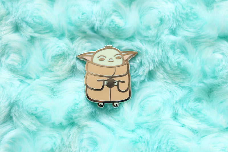 Baby Yoda Pin on Blue Fabric Background