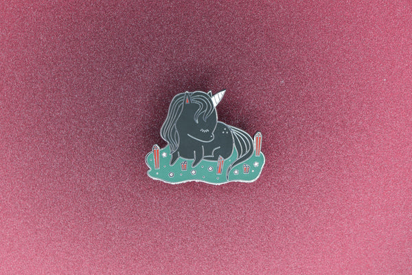 Hard Enamel Pin of a Black Unicorn in a field of Red Crystals