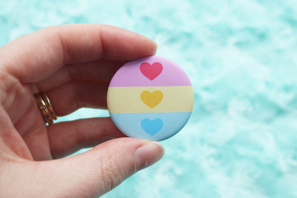 Hand Holding Pansexual Flag Button