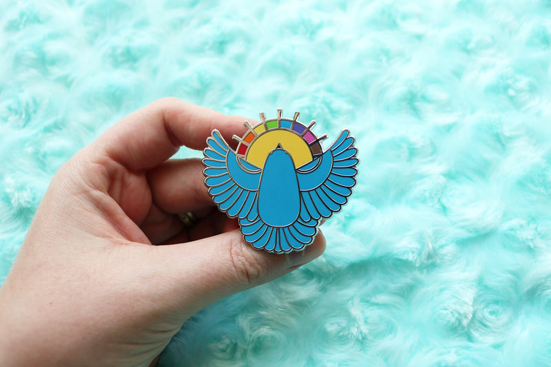 Holding Blue Bird Pin