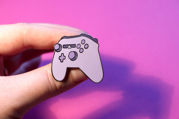 Cool Purple Xbox Controller Hard Enamel Pin on Pink Background