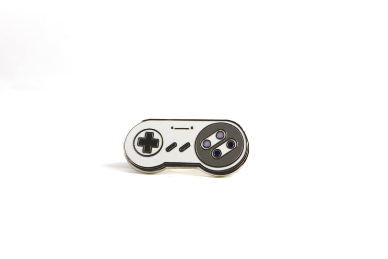 Gray SNES Controller Hard Enamel Pin on White Background