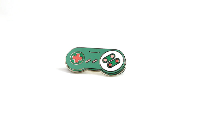Green and Pink SNES Controller Hard Enamel Pin on White Background