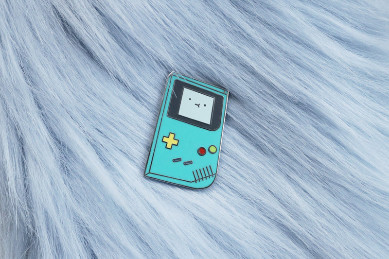 BMO from Adventure Time Inspired Game Boy Enamel Pin on Blue Fur Background