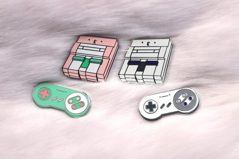Pink and Gray SNES Consoles and Controllers on Pink Fur Background