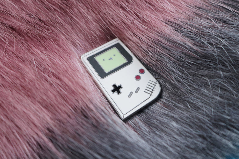 Game Boy Hard Enamel Pin on Maroon and Gray Fur Background