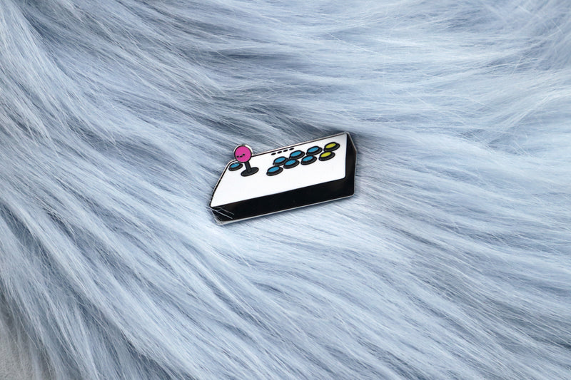 White Fight Stick with Pink Balltop Hard Enamel Pin on Blue Fur Background