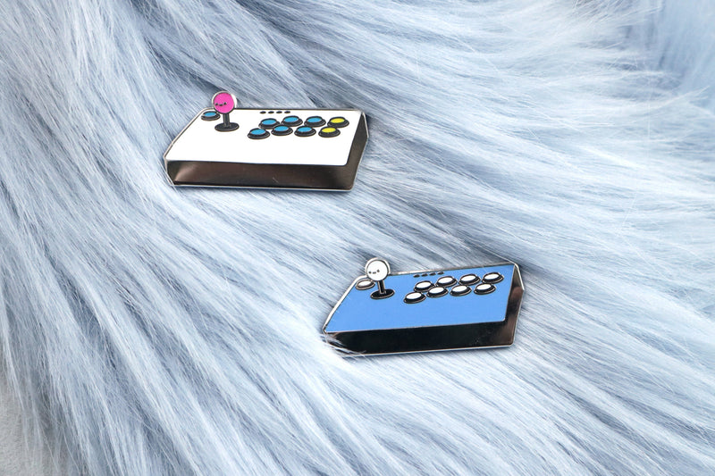 White and Blue Fight Stick Hard Enamel Pins on Blue Fur