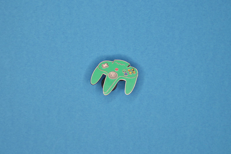 Jungle Green N64 Controller Hard Enamel Pin on Blue Background