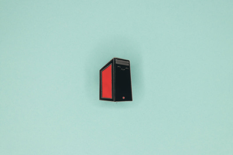 Black PC Tower with Red Side Panel Hard Enamel Pin on Blue Background