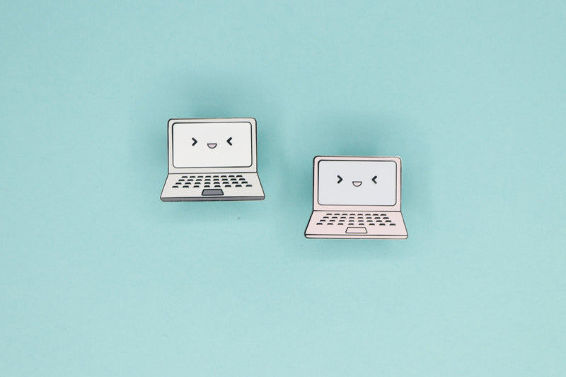 Two Laptop Hard Enamel Pins on Teal Background