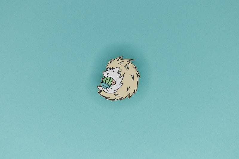 Albino Hedgehog Holding a Barrel Cactus Hard Enamel Pin by Dbl Feature