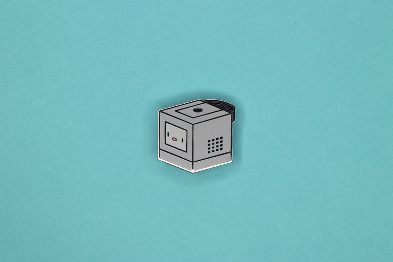 Platinum GameCube Hard Enamel Pin on Teal Background