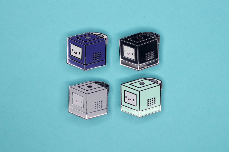 Four GameCube Pins on Teal Background