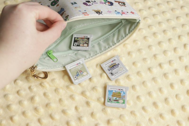 Interior zip pocket of Animal Crossing Pouch with 3DS Games
