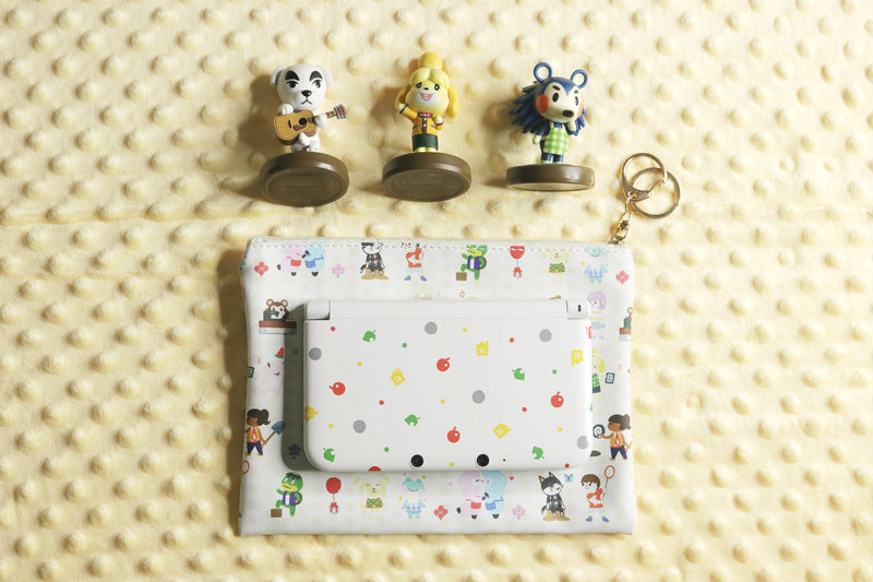 K.K. Slider, Isabelle, and Mabel Amiibos with Animal Crossing Pouch and 3DS