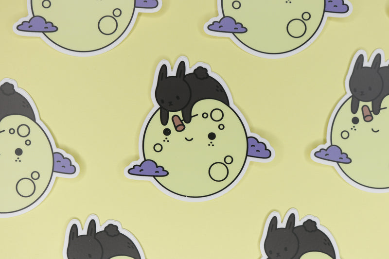 rows of black bunny on yellow moon stickers