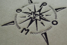 Load image into Gallery viewer, Closeup of pome compass logo on crewneck sweatshirt
