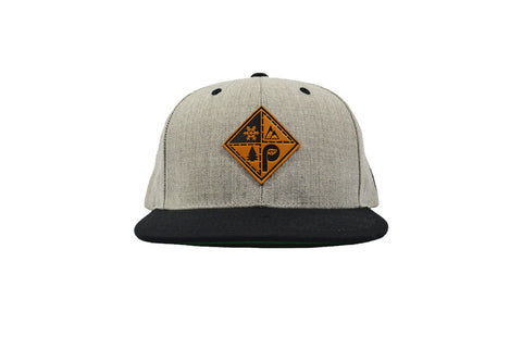 front view of grey black snapback patch hat